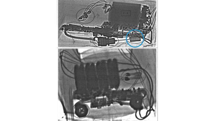 De bom zoals die door het Belgisch-Iraanse koppel in hun autokoffer werd gevonden. Het omcirkelde onderdeel is de antenne.