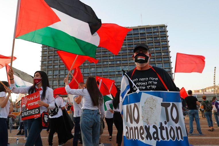 Demonstranten protesteerden vorig jaar in Tel Aviv tegen uitbreiding van Israëlische nederzettingen op de bezette Westelijke Jordaanoever.  Beeld AFP
