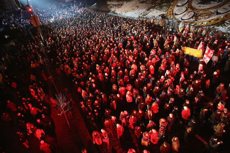Duizenden mensen herdenken het massaprotest op het Onafhankelijkheidsplein. Beeld GETTY