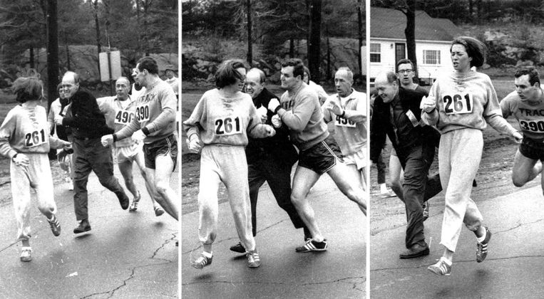 Racedirecteur Jock Semple (in zwarte jas) tracht Kathrine Switzer in 1967 uit de Boston Marathon te verwijderen. Dat wordt belet door haar vriend. Beeld AP