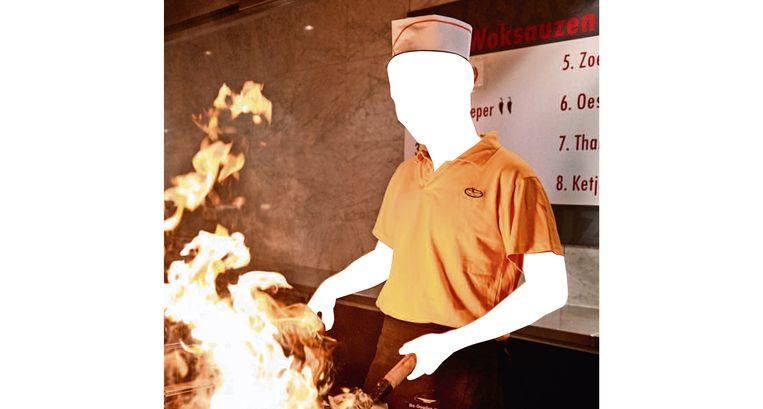 Veel Aziatische koks wokken in Nederlandse restaurants.  Beeld ANP/Martijn Beekman - bewerking Trouw