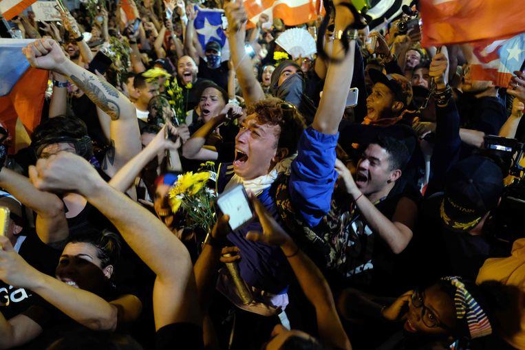 Feest op straat in Puerto Rico nadat Rosselló zijn aftreden had bekendgemaakt.  Beeld AFP