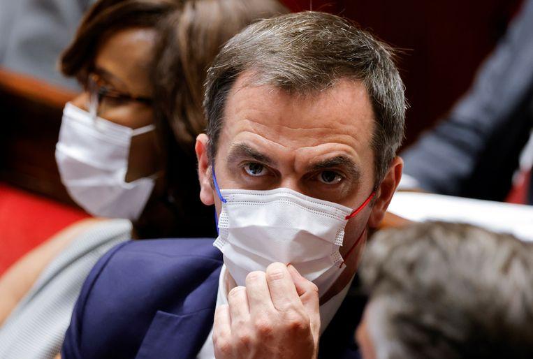 De Franse minister van Volksgezondheid Olivier Veran vandaag in het Franse parlement. Beeld REUTERS