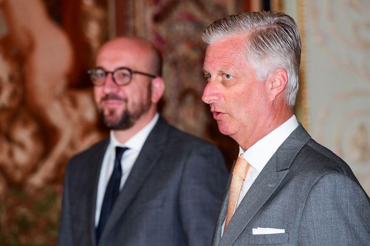 Koning Filip met premier Michel. Beeld BELGA