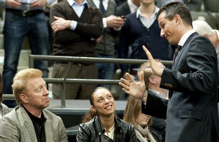 Richard Krajicek kletst bij met Boris Becker. Beeld anp