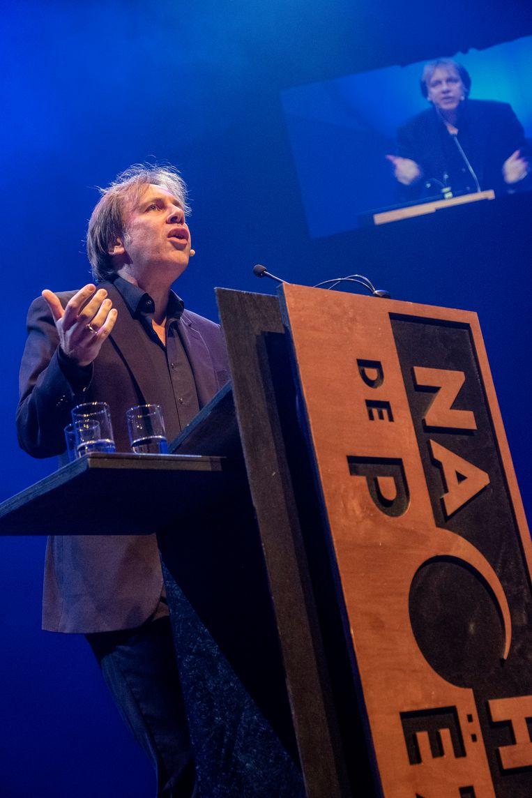 Dichter Ingmar Heytze tijdens zijn optreden in 2019 op de 37ste Nacht van de Poëzie in TivoliVredenburg in Utrecht. Beeld Hollandse Hoogte