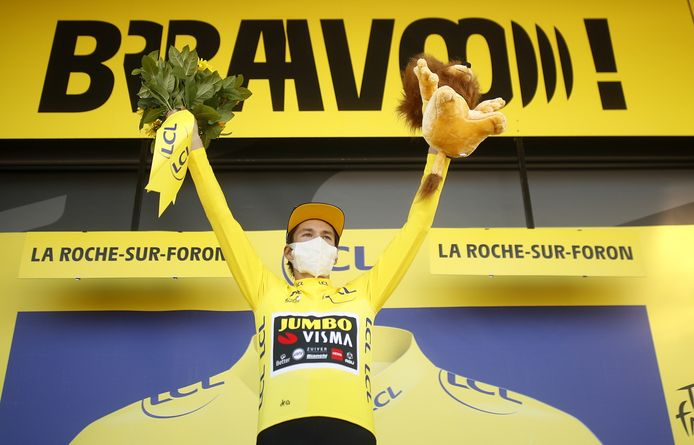 epa08676515 Overall leader Slovenian rider Primoz Roglic of Team Jumbo-Visma celebrates on the podium after retaining the Yellow Jersey at the of the 18th stage of the Tour de France over 175km from Meribel to La Roche-sur-Foron, France, 17 September 2020.  EPA/Stephane Mahe / Pool