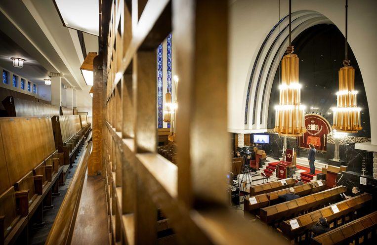De herdenking van de Kristallnacht vond dit jaar plaats in de Amsterdamse Rav Aron Schuster synagoge. Beeld ANP