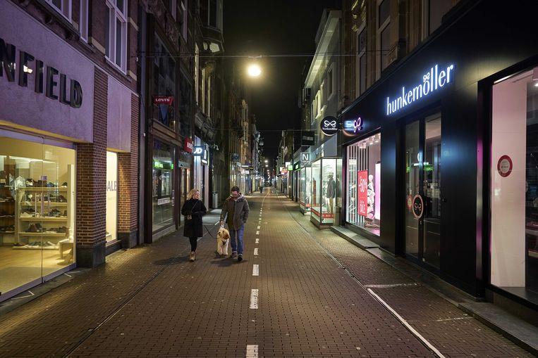 Een lege winkelstraat in Den Haag. Beeld ANP