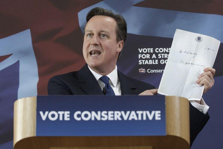 Premier David Cameron vecht voor zijn politiek overleven donderdag. Beeld AP