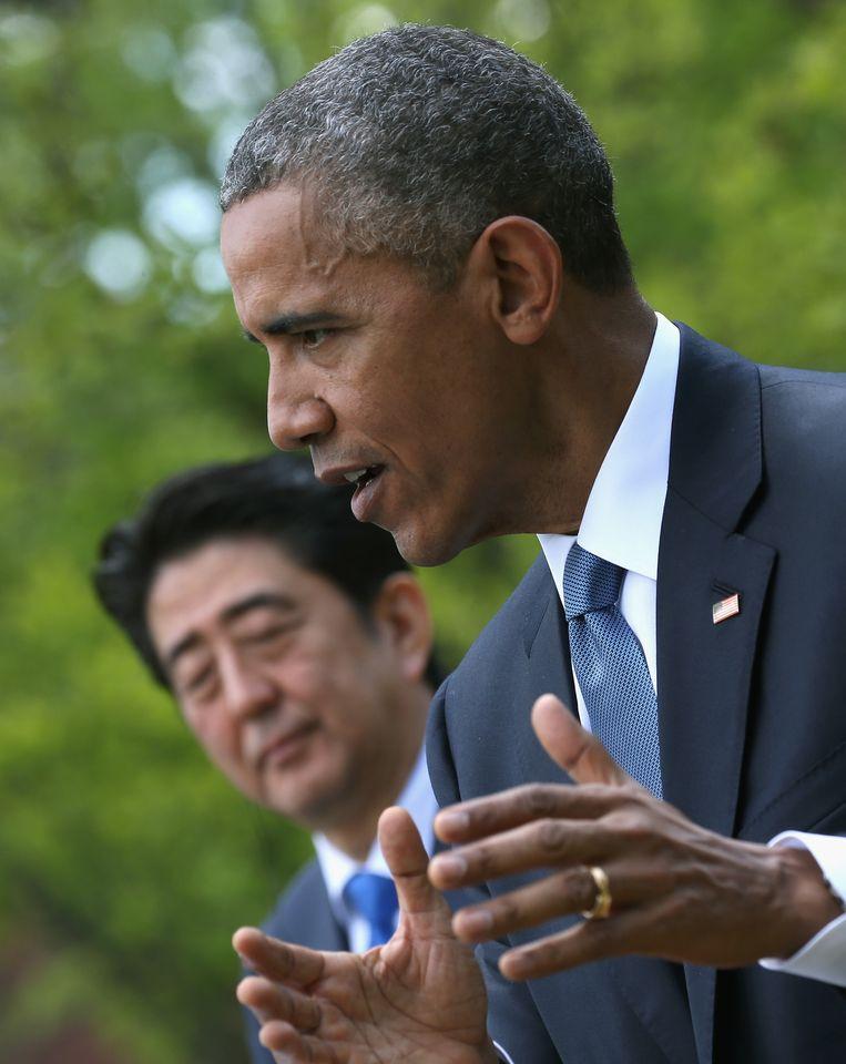 Barack Obama sprak in aanwezigheid van de Japanse premier Shinzo Abe. Beeld GETTY
