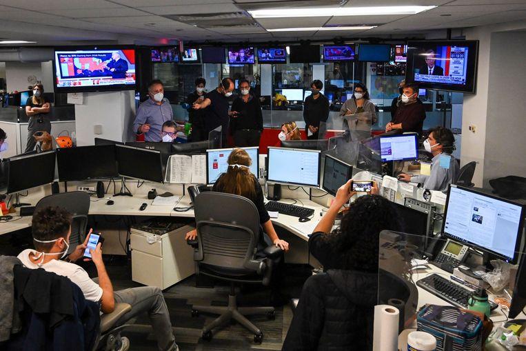Journalisten van persbureau AFP aan het werk tijdens verkiezingsnacht.  Beeld AFP