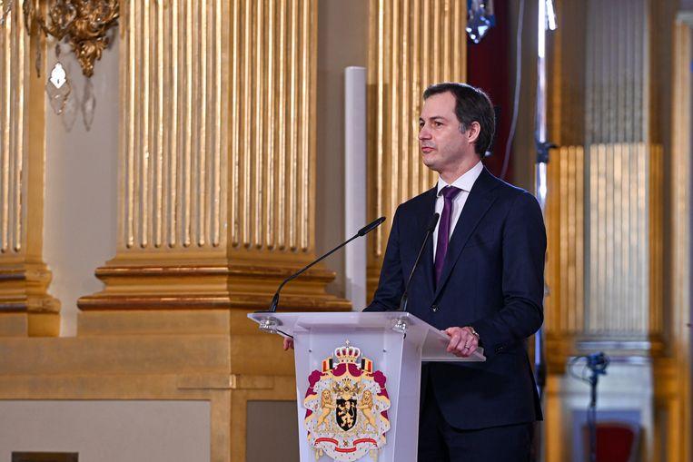 """""""Nu we al zo ver zijn geraakt, mogen we niet lossen"""", sprak de eerste minister. Beeld BELGA"""