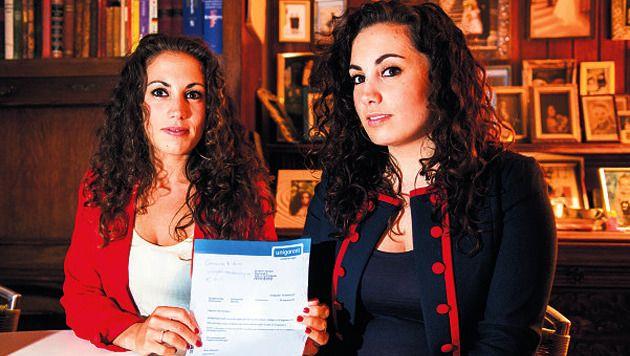 Felicia en Giulia Giordano tonen een brief over de claim.
