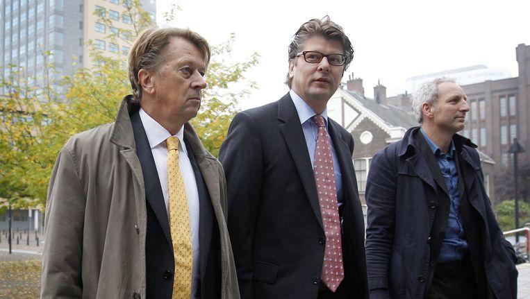 Directeur van Chipshol Peter Poot (links) en zijn broer Cees Poot (midden). Beeld anp