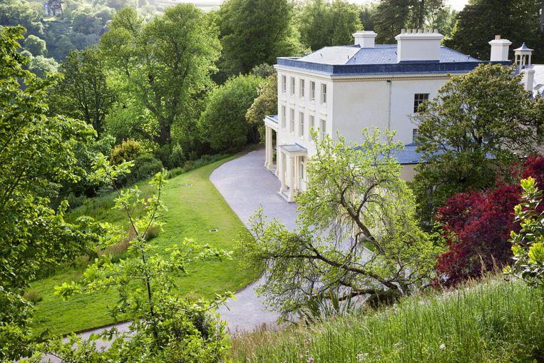 Het statige Greenway House, met als blikvanger de 'drawing room' waar Agatha Christie vaak pianospeelde. Beeld Alamy Stock Photo