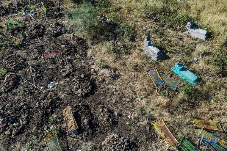 Massagraven bij Mai Kadra. Beeld Eduardo Soteras Jalil / AFP