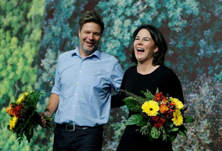 Het voorzittersduo Robert Habeck en Annalena Baerbock neemt het tegen elkaar op als kanselierskandidaat. Beeld Reuters