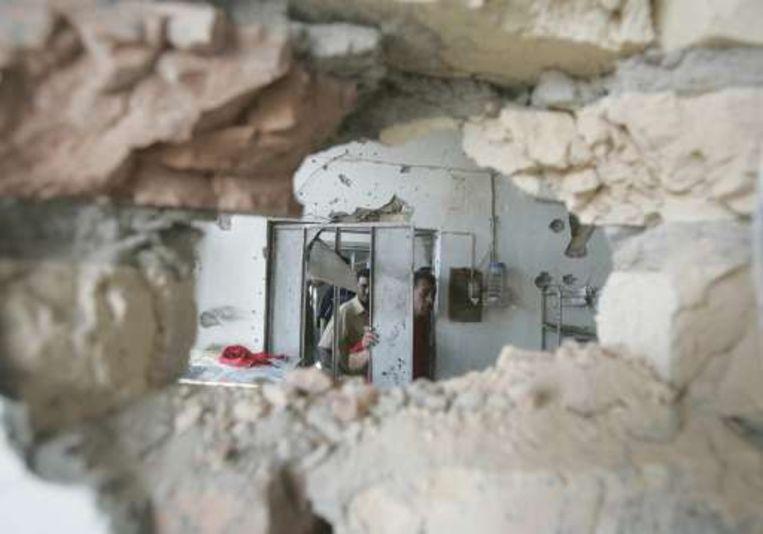 De schade na de bombardementen in Sadr-City.