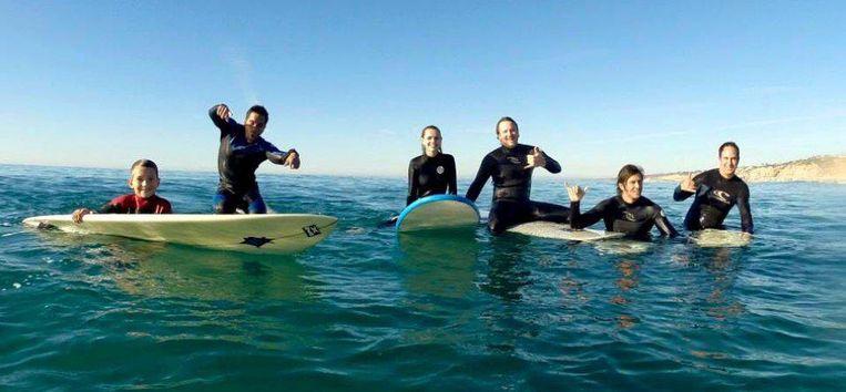 De gelukkige werknemers van Tower Paddle Boards Beeld Tower Paddle Boards