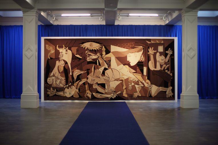 Een wandkleed van Picasso's 'Guernica' . Beeld Getty Images