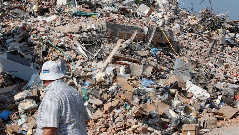 Een ingestort gebouw in Cavezzo in het noorden van Italië. Beeld AP