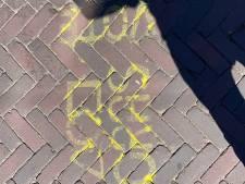 Stoepkrijtleuzen van studentenpartij scheppen verwarring