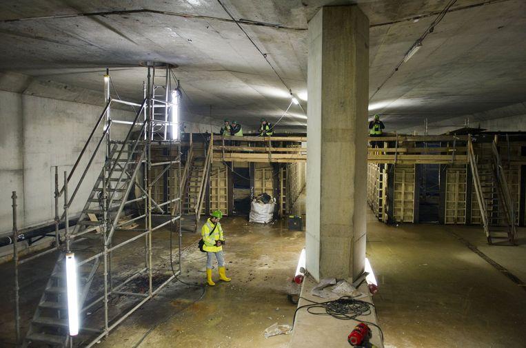Werkzaamheden aan de Noord/Zuidlijn onder Amsterdam CS. Beeld anp