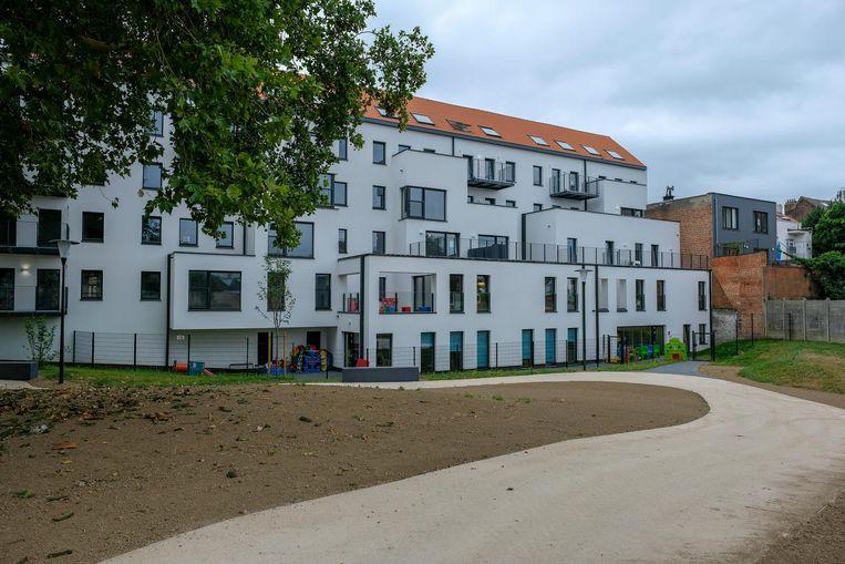 De woonblok richt zich op de binnenkoer van het Scheutpark.