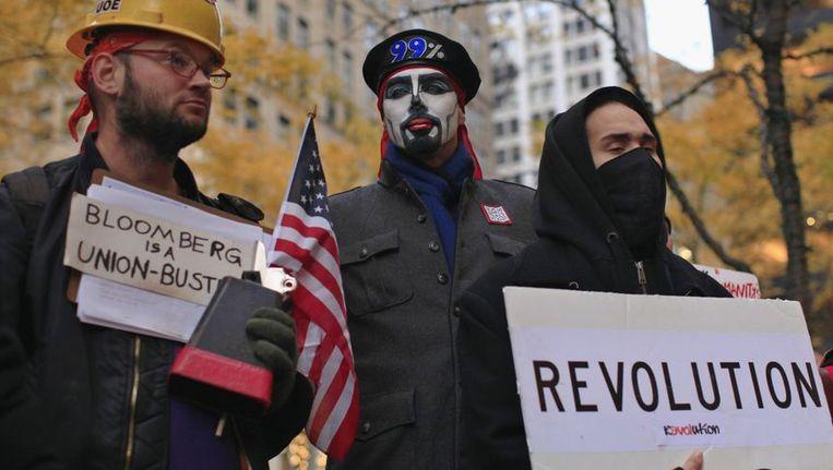 Occupy Wall Street-betogers tijdens de dagelijkse bijeenkomst in het New Yorkse Zuccotti Park. Beeld REUTERS