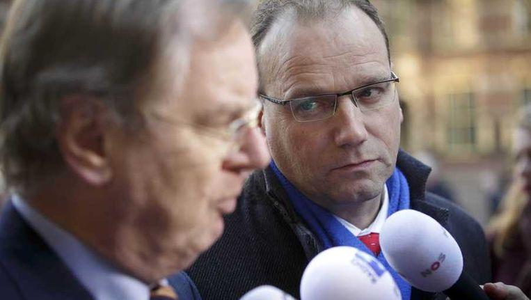 FNV-voorzitter Ton Heerts (R) en Bernard Wientjes, voorzitter van werkgeversorganisatie VNO-NCW, eind november op het Binnenhof. Beeld anp