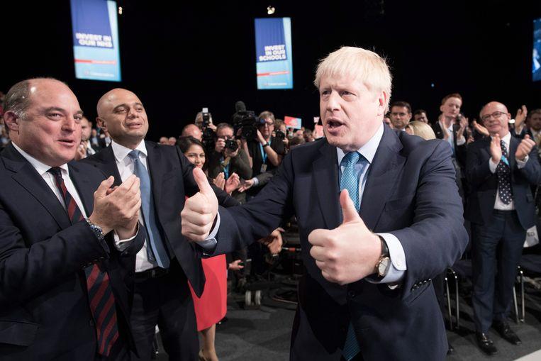 Premier Johnson na zijn toespraak op zijn partijcongres in Manchester, woensdag.  Beeld EPA