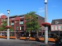 Het eerste ontwerp voor extra woningen bovenop het blok aan het Statenplein.