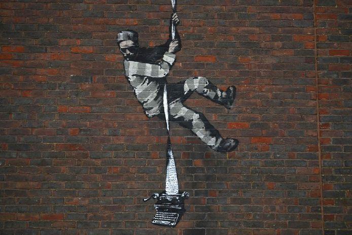 Een kunstwerk van Banksy op de muur van Reading Gaol