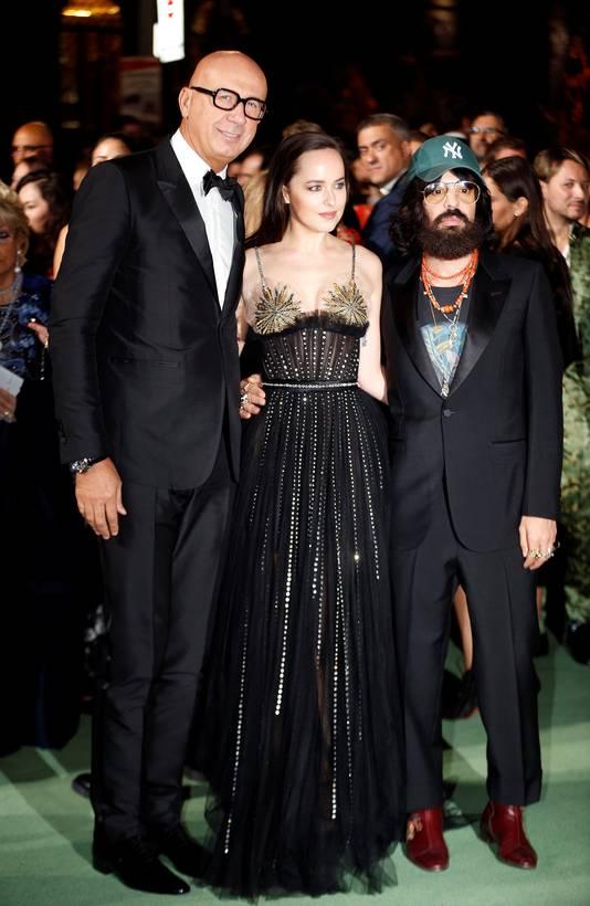 Gucci-CEO Marco Bizzarri (links) tijdens de Milan Fashion Week.