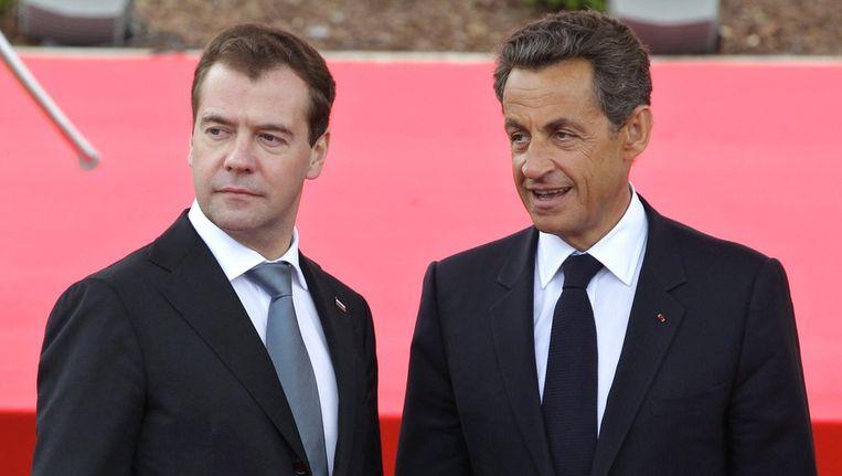 De Russische president Medvedev en de Franse president Sarkozy. Beeld EPA