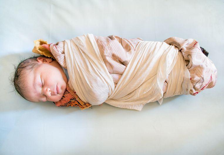Een pasgeboren in Kalaat M'Gouna in Marokko.  Beeld ©Lieve Blancquaert