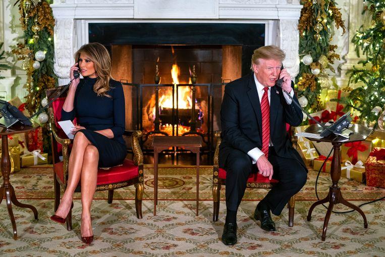 Volgens president Trump en zijn vrouw Melania is meedoen aan NORAD een van de leukste tradities van het Witte Huis.  Beeld EPA