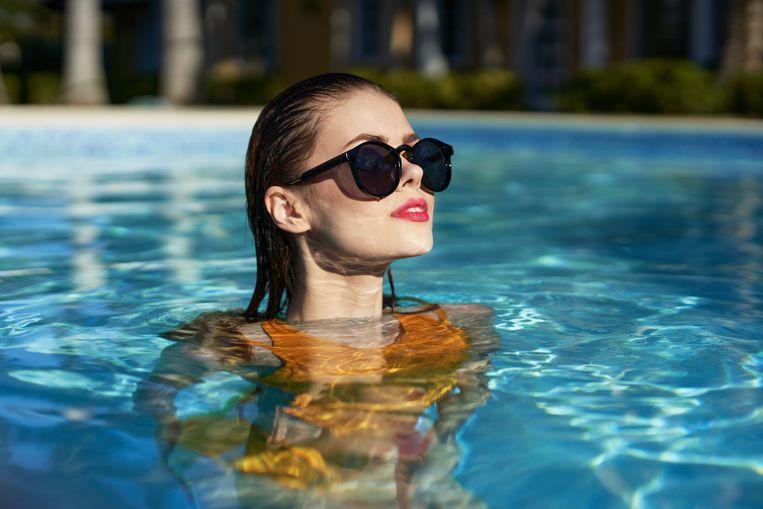 Vrouw met zonnebril Beeld Getty Images