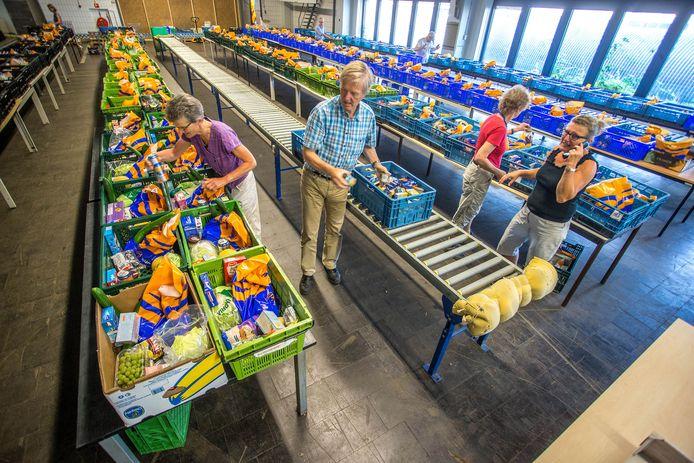 De vrijwilligers van de voedselbank krijgen het steeds drukker. (Archieffoto)
