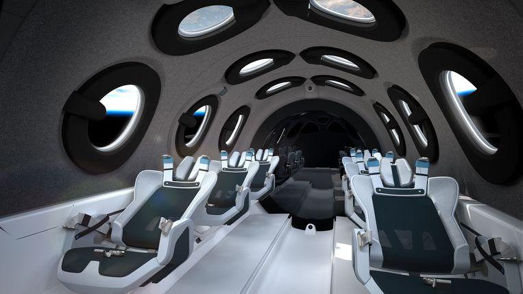 Interieur van het  ruimteschip dat   Richard Branson zondag in hogere sferen moet brengen.  Beeld AFP