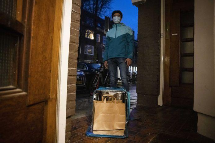 Een maaltijdbezorger op pad. Foto ter illustratie.