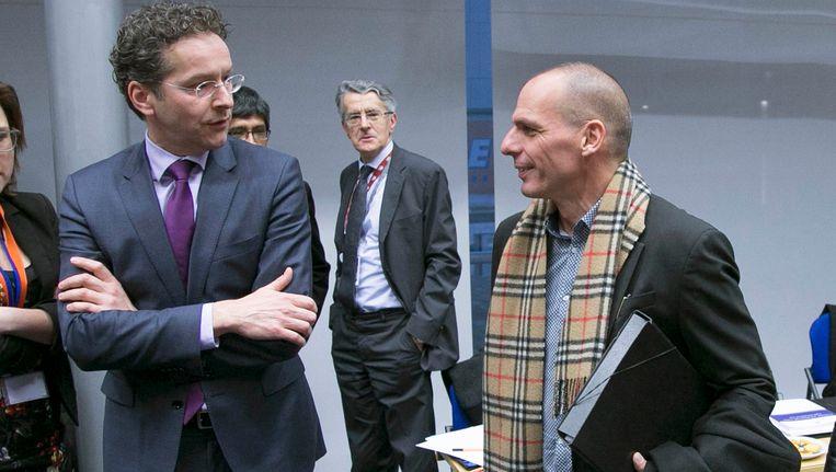 Eurogroepvoorzitter Jeroen Dijsselbloem (links) en de Griekse minister van Financiën Varoufakis. Beeld REUTERS