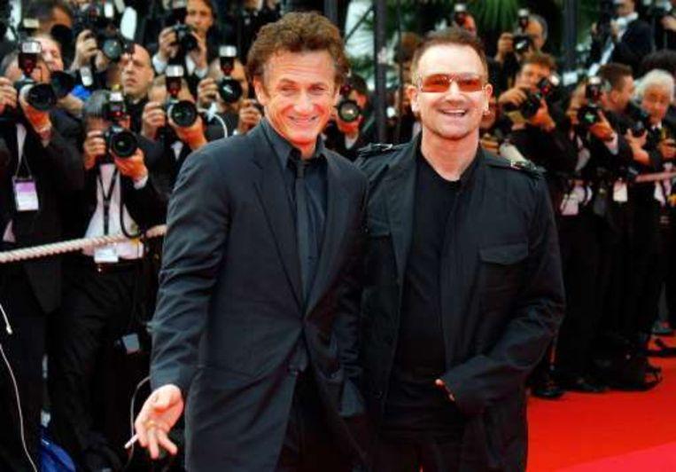Sean Penn naast zanger Bono Beeld UNKNOWN
