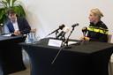 Burgemeester Depla en sectorhoofd Frederiek Schouwenaar van de politie tijdens een persconferentie maandag in Breda