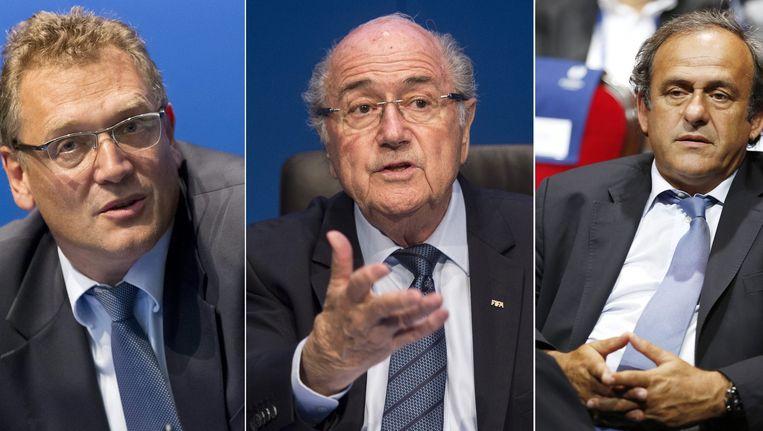 De drie gescshorste topfiguren op een rijtje: Valcke, Blatter en Platini.