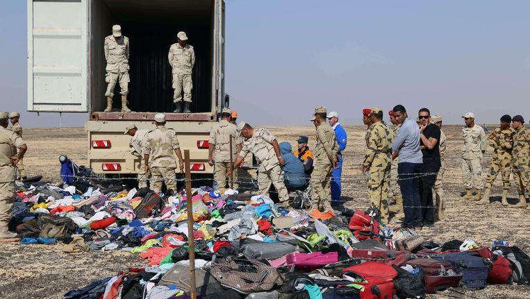 Russische onderzoekers bij de rampplek. Beeld afp