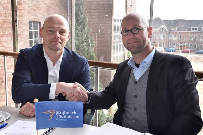 Wethouder Gerrie Elfrink en Harold van Rooijen van KlokBouwOntwikkeling.