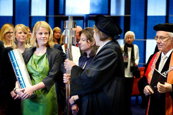 Een promotieplechtigheid in Rotterdam. Voor zwangere vrouwen was het vaak extra stressen om hun onderzoek tijdig af te ronden. Dat is nu verleden tijd.