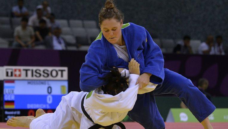 Roxane Taeymans (in het blauw) sneuvelde in de tweede ronde.